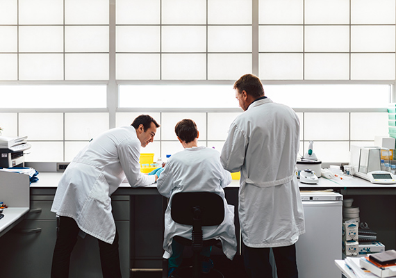 Picture of 3 men working on a laboratory