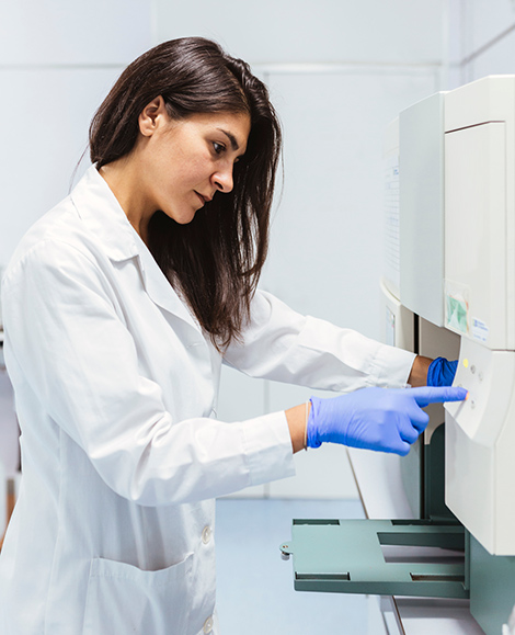 QA professional working with lab equipment