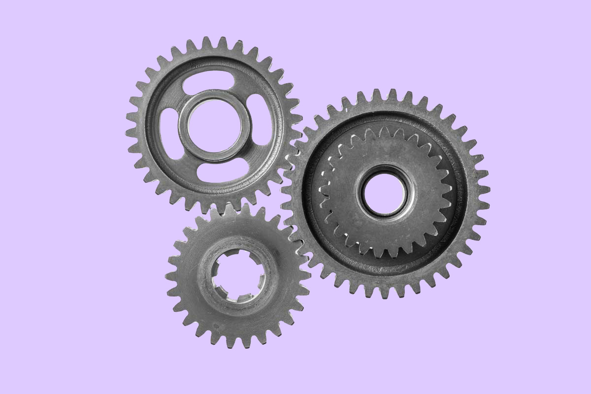 Picture of a gear on purple background to represent the importance of team training on the Life Sciences companies