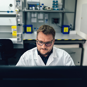 Picture of a man working with a computer in a laboratory
